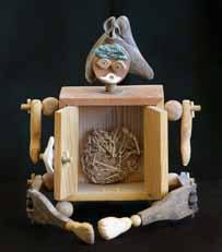Mimi Patrick's Box Boy made of wood, bone, stone and shell  from Wally Cuchine's exhibit
