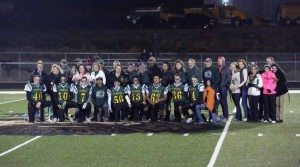 Courtesy photo The seniors for the 2015 Eureka County High football team gather at halftime with their parents and loved ones for Senior Appreciation Night last Friday. Eureka defeated Owyhee 86-16 to finish the regular season 8-0. The Vandals will get another game on their home turf when they host Virginia City in the regional playoffs next Friday at 7 p.m.