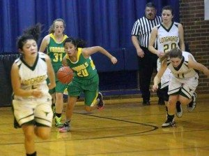 Courtesy photo Eureka's Morgan Thomas (20) is followed by Elsie Etchegaray (31) as they look to push the ball against Battle Mountain during the Lady Vandals 31-30 win over the weekend at the Comstock Classic in Virginia City.
