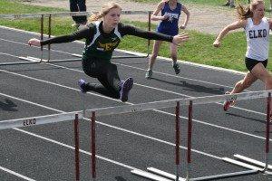 Sophomore Cody Gibbs clears the hurdle in the 100 meter hurdles.