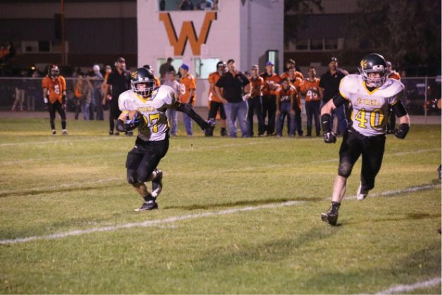 File photo -  Eureka County High running back Jake Jensen carries the ball for the Vandals last year in a win against Wells. The senior injured his knee and won't be able to play when his team opens up the season tonight at home against Pyramid Lake. Eureka is coming off an incredible 8-1 campaign in 2015 where their only blemish was a 20-14 loss to Virginia City in the playoffs. The Vandals first four games this season are at home before hitting the road on Sept. 24 at North Tahoe.