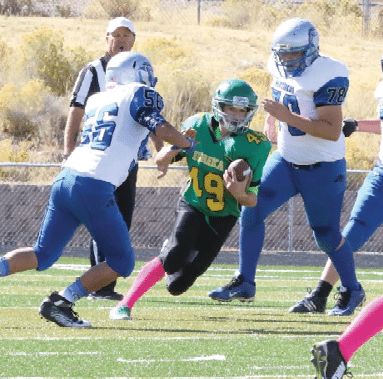 Courtesy photo - Wyatt Anderson for Eureka runs the ball against the Pahranagat Valley Panthers this past Saturday during a junior high football game at Crutchley Field. Eureka beat the Panthers 24-8 to stay undefeated in junior high football games for Northern Nevada. Eureka is coached by Aitor Eskandon, Nate Johnson and Juan Davilla.