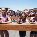 A trio of kids prepare for the soda drinking contest.