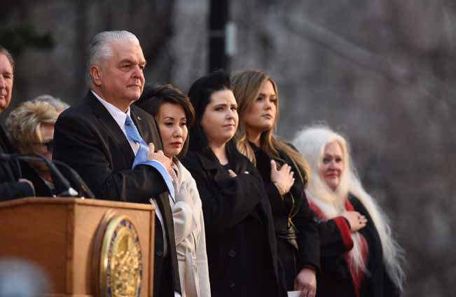 David Calvert photos/The Nevada Independent  Gov. Steve Sisolak stands during an inauguration ceremony on the steps of the Nevada State Capitol in Carson City on Monday.